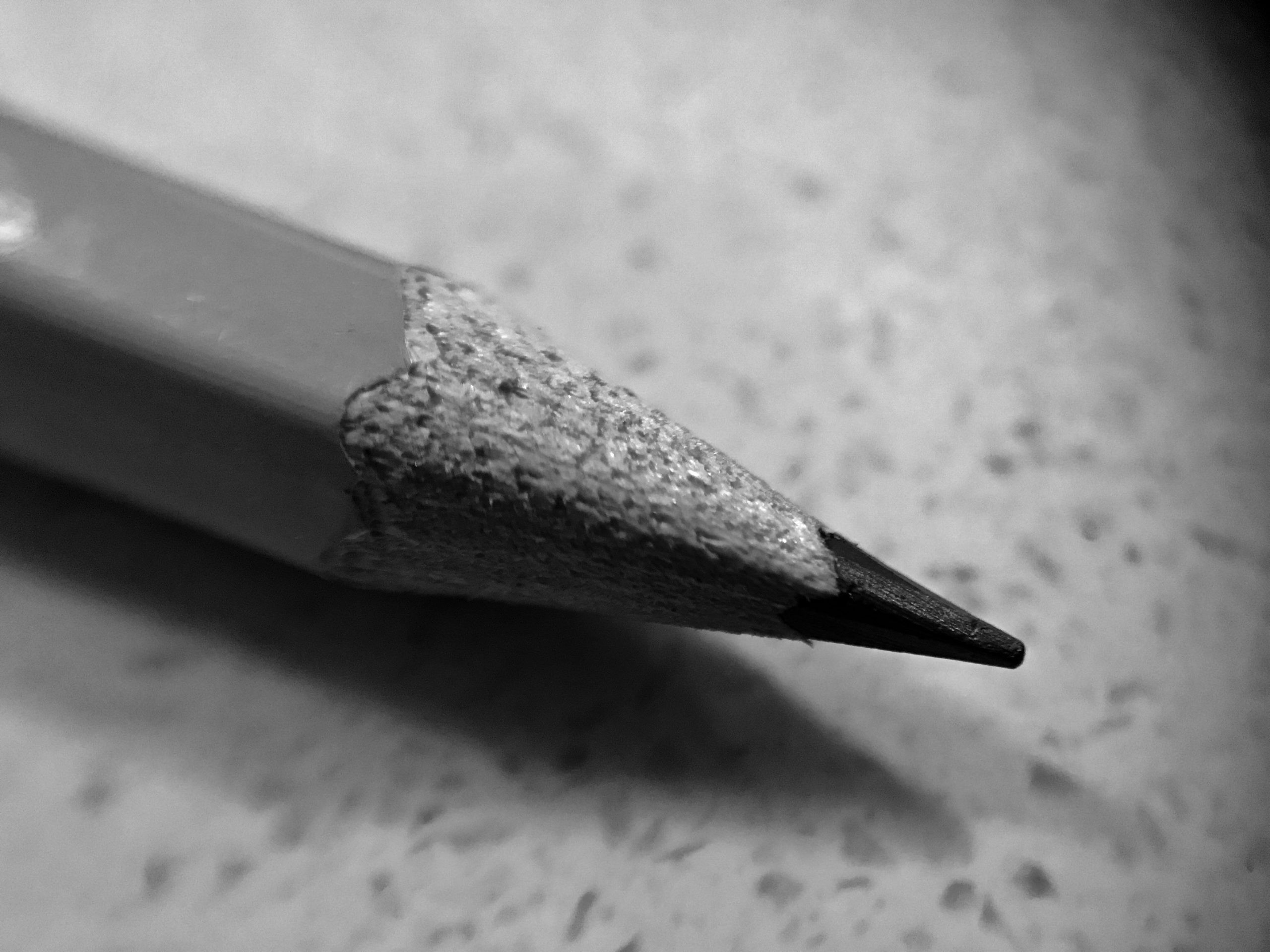 Image of a well sharpened pencil in back and white.